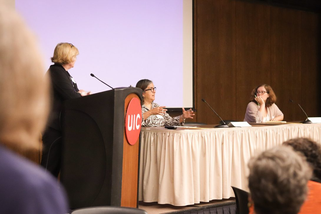 Moderator Maryfrances Miley on stage with panelists Aixa Alfonso and Sara Hall
