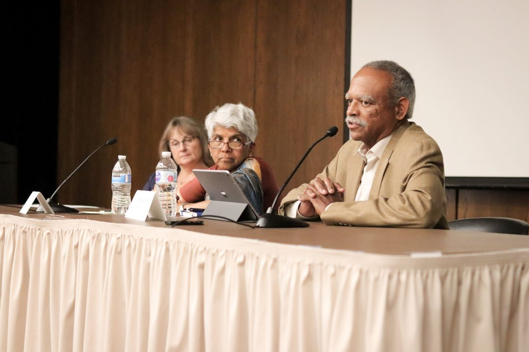 Meena Rao and William Walden sitting on stage