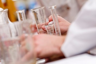 scientist with beakers